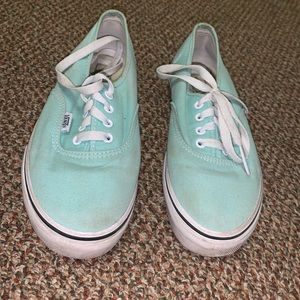 Sea-glass green low vans.